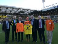 From left to right with Jeremy Ravn, Director of the Trussell Trust, Constantine Panayotou - Alex's Manager, David Mc Nally Chief Executive Norwich City FC, Alex,  Noel Atkins, Chairman, board Trussell Trust, Grant Haversham of Norwich Foodbank, Mark Elling - Events Manager of Trussell Trust and Alex's team member